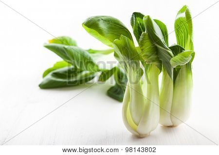 Chinese cabbage pak choi on wooden table