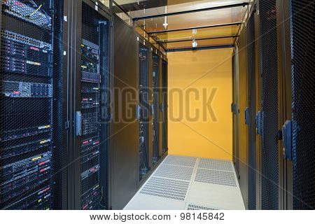 Climate controlled datacenter showing racks of internet servers
