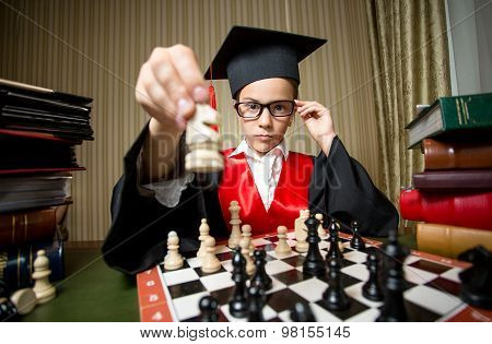 Smart Girl In Graduation Cap Making Move At Chess With Horse