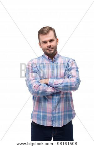 Young Handsome Man With Crossed Hands. Isolated.
