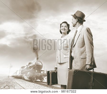 Elegant Vintage Couple Leaving With Luggage