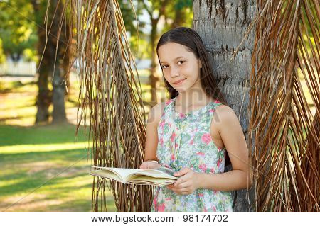Cute Smiling Teen Girl Reading Book