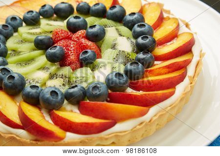 Fresh Fruits On Top Of Tasty Cake With Frosting