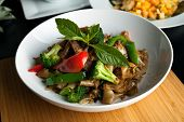 Pad kee mao drunken noodle thai dish with beef and mixed vegetables. poster