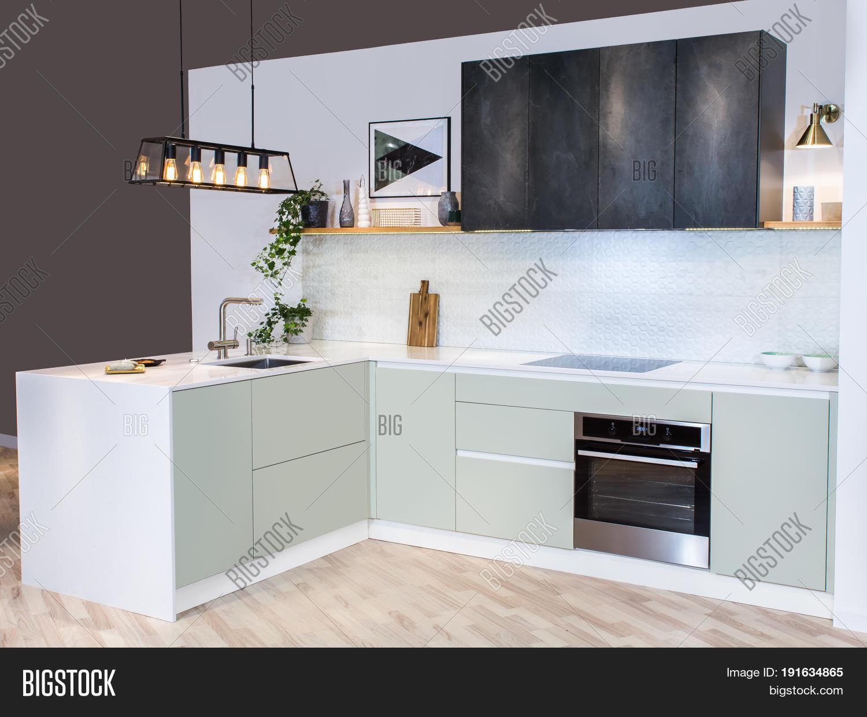 Modern home interior front view of modern kitchen design in a light interior facades