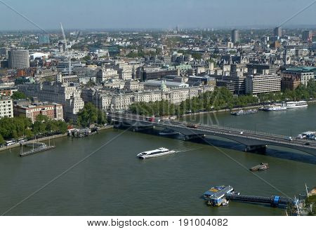 LONDON - UK - MAY, 2011: Panoramic views of the River Thames and bridges. A leisure boat sails along the Thames near the bridges. Sights of England. Top view.