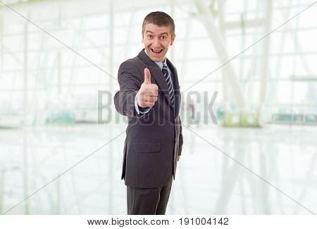 silly business man going thumb up, at the office