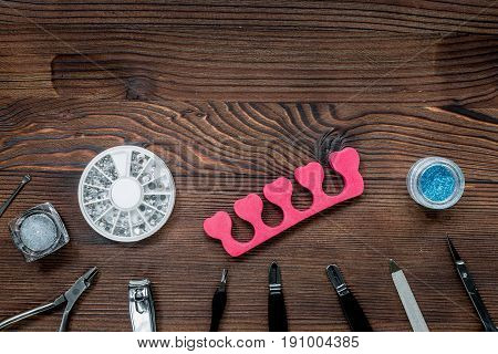 manicurist work place with manicure set for hands care on wooden background top view mock up