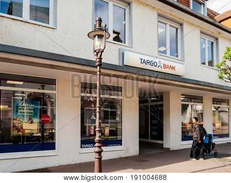 RASTATT GERMANY - APR 13 2017: Targo bank branch in German city with woman walking in front. argobank (formerly Citibank Germany) is the German retail banking arm of Credit Mutuel.