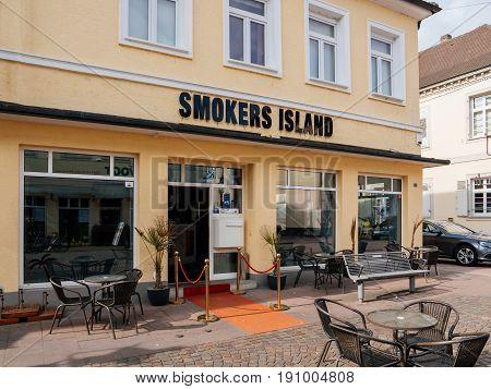 RASTATT GERMANY - APR 13 2017: Smokers Island pub bar with empty terrace in German city of Rastatt