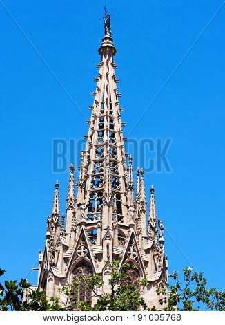 Large church steeple in Barcelona Spain against blue sky