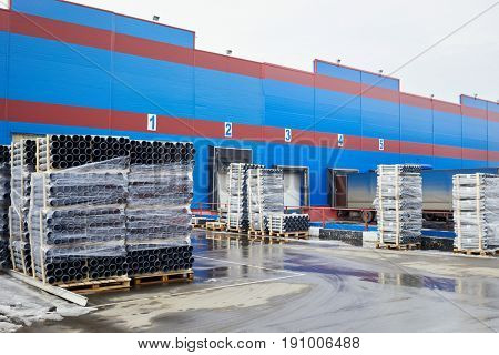 Plenty of plastic water pipes at outdoor storage.