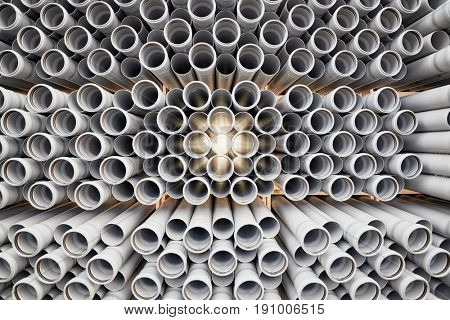 Packaged plastic pipes at warehouse.