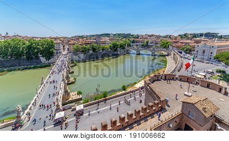 ROME ITALY - MAY 31 2017: Aerial view of the old town of Rome with the Ponte Sant Angelo from San Angelo castle and unidentified people. Old town of Rome is listed under the UNESCO world heritage.