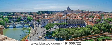 ROME ITALY - MAY 31 2017: Panoramic aerial view of the old town of Rome from San Angelo castle with Vatican Basilica in background. Old town of Rome is listed under the UNESCO world heritage.