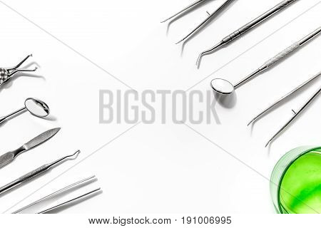 dentist desk with instruments in hospital on white background top view mock up