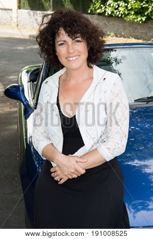 Cheerful Woman Forties In Street With Car