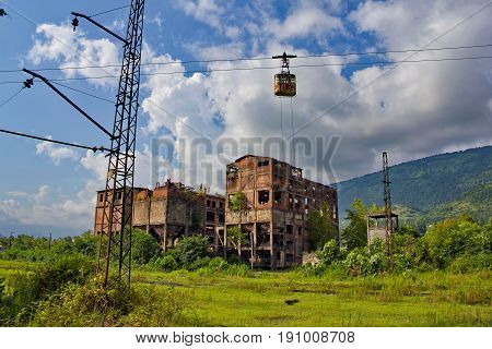 Abandoned train station, factory and cable car in Tquarchal (Tkvarcheli). Abkhazia, Georgia