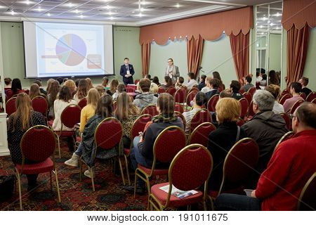 MOSCOW, RUSSIA - JAN 22, 2017: Group of people watch presentation during Studinter exhibition Education Abroad for All in Radisson Slavyanskaya Hotel and Business Center.