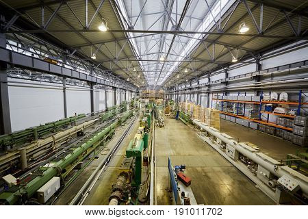 MOSCOW, RUSSIA - MAR 01, 2017: Workshop with people work on conveyor at Sinikon factory. The joint Russian-Italian company Sinikon was founded in 1996.
