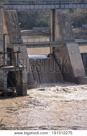 Hydroelectric power station in Mengibar releasing water after heavy rains of winter in the province of Jaen Spain