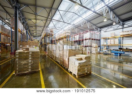 MOSCOW, RUSSIA - MAR 01, 2017: Cardboard boxes with pipe fittings on pallets in factory warehouse. The joint Russian-Italian company Sinikon producing plastic pipes was founded in 1996.