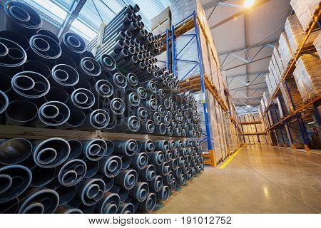 MOSCOW, RUSSIA - MAR 01, 2017: Cardboard boxes on shelves and plastic pipes at warehouse of Sinikon factory. The joint Russian-Italian company Sinikon producing plastic pipes was founded in 1996.