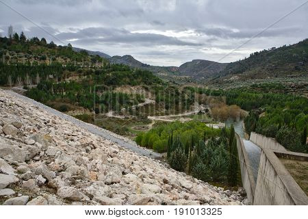 Colomera reservoir releasing water after heavy rains of winter is situated on the river Colomera and Juntas near the town of Colomera in the province of Granada Spain