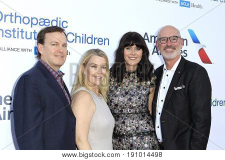 LOS ANGELES - JUN 10: Fred Cromer, Katie Cromer, Jennifer Courpron, Henri Courpron at the 2017 Stand For Kids Annual Gala Orthopedic Institute For Children on June 10, 2017 in Los Angeles, California