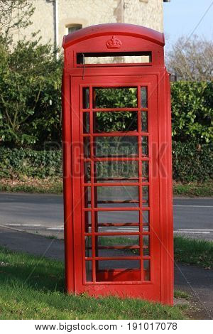 British telephone box which has been vandalised and has no windows left. An iconic part of British history.