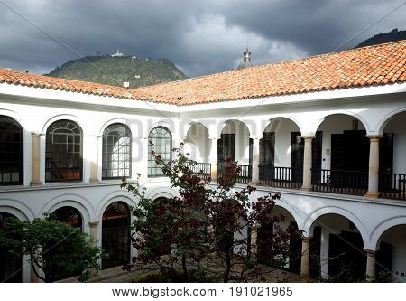 The courtyard of the Banco de la Republica Art museum with Monserrate in the background Bogota Colombia
