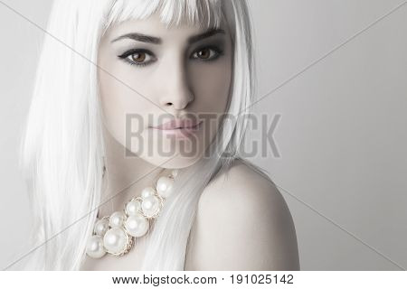beautiful young woman with modern platinum hairstyle