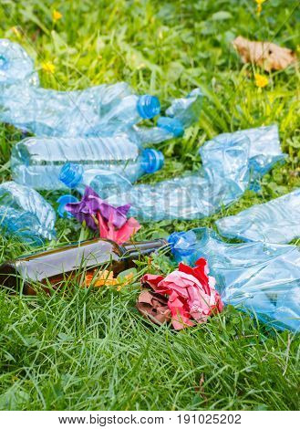 Heap Of Rubbish On Green Grass In Park, Concept Of Littering Of Environment