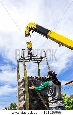 construction site men working crane load tile roof for building