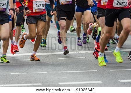BERLIN - APRIL 02 2017: The annual 37th Berlin Half Marathon. Athletes are running. Legs of athletes close-up.