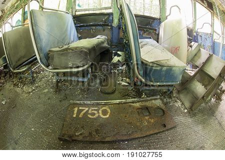 Seats And Sign Inside Abandoned Trolley Car