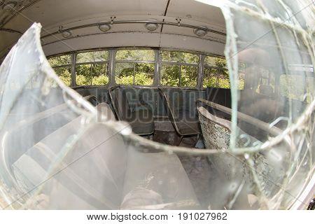 Damaged Bus Through Broken Window