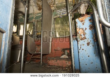 Colorful Seats Of Abandoned Trolley Car