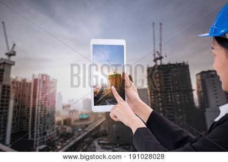 Asian Business Engineer Architecture Professional Woman, Wearing Safety Helmet And Use Smartphone To