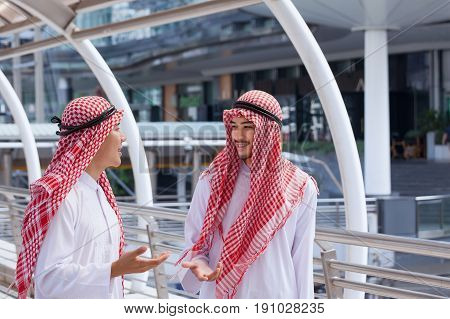 Two Arabian Business Men Discuss And Walk Together Around Modern City