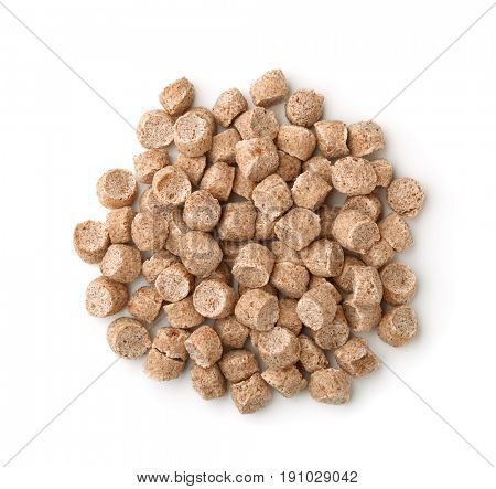 Top view of extruded wheat bran pellets isolated on white