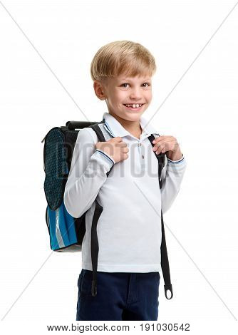 Portrait of cute smiling young boy wearing schoolbag