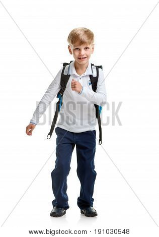 Young happy smiling boy with bag going to school on white background