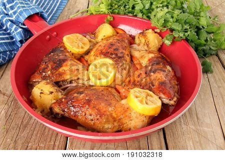 Roasted free range organic Chicken dinner with potatoes, carrots, lemon and cilantro.