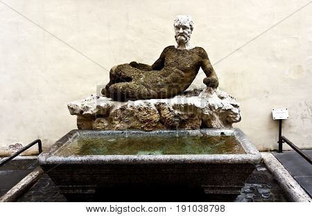 Rome, Italy - April 18, 2017: Babuino fountain in Via Condotti in the historical center of Rome.An ancient statue of Silenus, the Romans was mockingly called