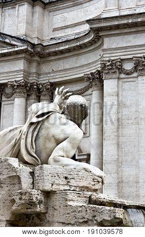 Rome, Italy - April 18, 2017:  River Nile in the Fontana dei Quattro Fiumi. The Niles veiled head symbolizes the rivers unknown source