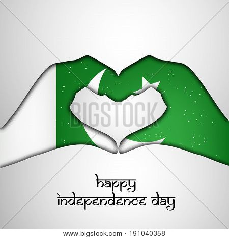 illustration of hands in Pakistan Flag background with Happy Independence Day text on the occasion of Pakistan Independence day