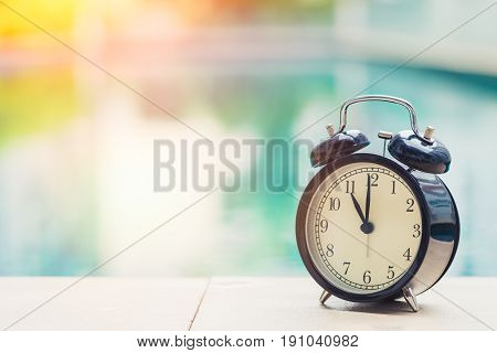 11 O'clock Retro Clock At The Swimming Pool Outdoor Holiday Time Concept.