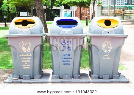 Three of recycle trash can in public park