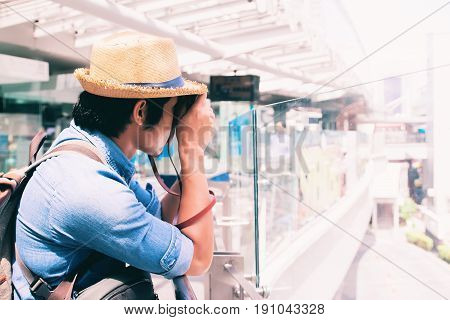 Asian man tourist taking photo at modern building Travel concept